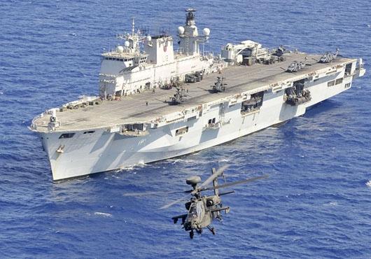 Commander of British Naval Task Force Returns to HMS Ocean